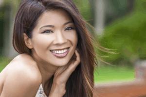 Beautiful woman sitting outside smiling