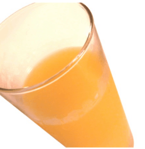 Close up image of a glass of fruit juice